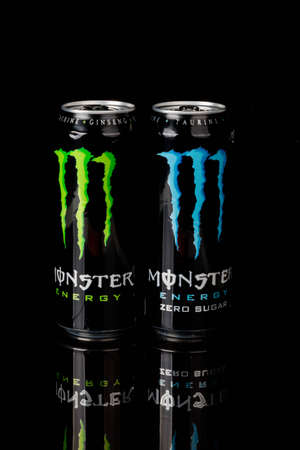 London, United Kingdom, 14th October 2020:- Cans of Monster & Sugar Free Energy Drinks Isolated on a black background Redakční