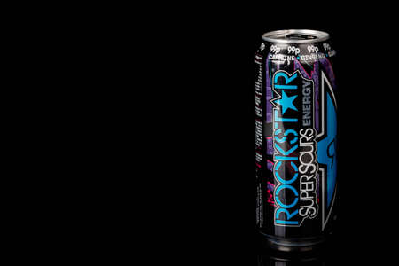 London, United Kingdom, 14th October 2020:- A can of Rockstar Blue Raspberry Energy Drink Isolated on a black background