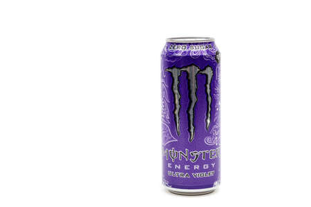 London, United Kingdom, 14th October 2020:- A Can of Monster Ultra Violet Energy Drink Isolated on a white background Redakční