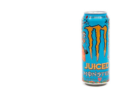 London, United Kingdom, 14th October 2020:- A can of Monster Mango Loco Energy Drink Isolated on a white background Redakční