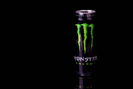 London, United Kingdom, 14th October 2020:- A Can of Monster Energy Drink Isolated on a black background Redakční