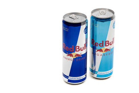 London, United Kingdom, 14th October 2020:- A can of Red Bull and Sugar Free Red Bull Energy Drink Isolated on a white background Redakční