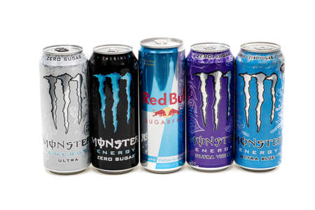 London, United Kingdom, 14th October 2020:-  Cans of Sugar Free Monster & Red Bull Energy Drinks Isolated on a white background