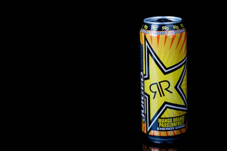 London, United Kingdom, 14th October 2020:- A can of Rockstar Mango Orange Passionfruit Energy Drink Isolated on a black background