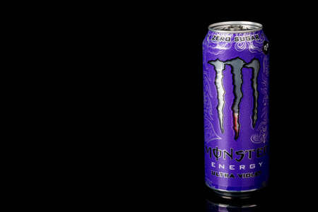 London, United Kingdom, 14th October 2020:- A can of Monster Zero Sugar Ultra Violet Energy Drink Isolated on a black background