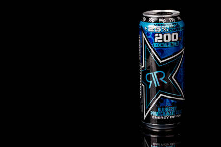London, United Kingdom, 14th October 2020:- A can of Rockstar Blueberry Pomegranate Acai Energy Drink Isolated on a black background