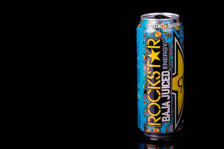 London, United Kingdom, 14th October 2020:- A can of Rockstar El Mango Energy Drink Isolated on a black background Redakční
