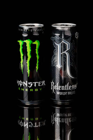London, United Kingdom, 14th October 2020:- Cans of Monster &  Relentless Energy Drinks Isolated on a black background