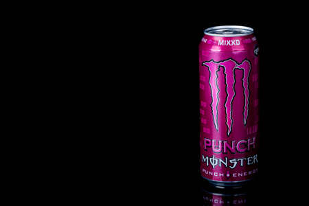 London, United Kingdom, 14th October 2020:- A can of Monster MIXXD Energy Drink Isolated on a black background Redakční