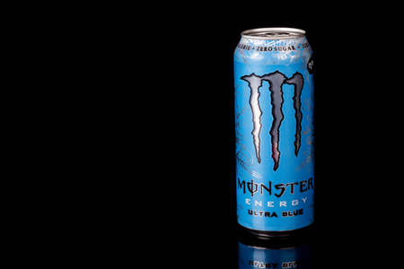 London, United Kingdom, 14th October 2020:- A can of Monster Ultra Blue Zero Sugar Energy Drink Isolated on a black background Redakční