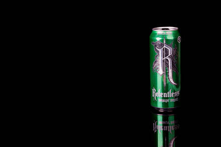 London, United Kingdom, 14th October 2020:- A can of Apple Kiwi Relentless Energy Drink Isolated on a black background Redakční