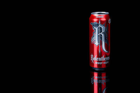 London, United Kingdom, 14th October 2020:- A Can of Cherry Relentless Energy Drink Isolated on a black background