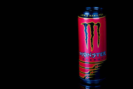 London, United Kingdom, 14th October 2020:- A can of Monster Lewis Hamilton Energy Drink Isolated on a black background