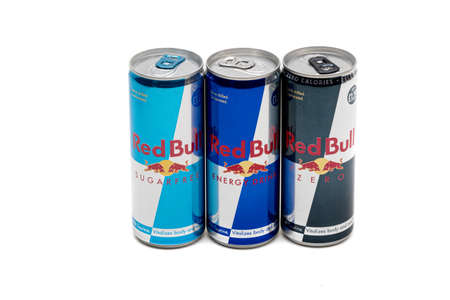 London, United Kingdom, 14th October 2020:- Cans of Red Bull, Sugar Free & Zero Energy Drinks Isolated on a white background