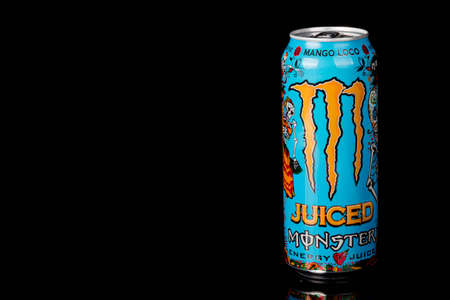 London, United Kingdom, 14th October 2020:- A can of Monster Mango Loco Energy Drink Isolated on a black background