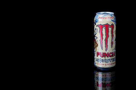 London, United Kingdom, 14th October 2020:- A can of Monster Pacific Punch Energy Drink Isolated on a black background