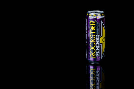 London, United Kingdom, 14th October 2020:- A can of Rockstar Tropical Guava Energy Drink Isolated on a black background