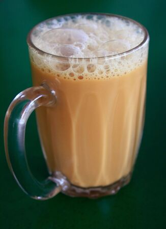 Teh tarik - milk tea with special treatment. A drink found in Malaysia and Singapore. Stock Photo - 2596164