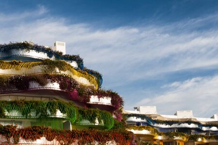 decorative balconies: balconies with flowers in Ibiza in the Balearic Islands Stock Photo