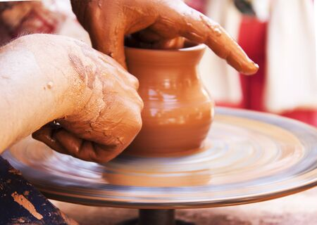 detail of the hands of a potter working