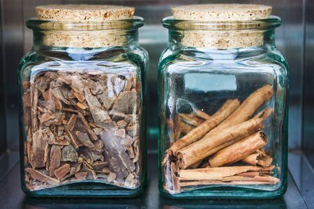 Two glass jars of spices and cork plugs 免版税图像