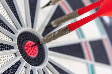 detail of three darts stuck in a dartboard 免版税图像