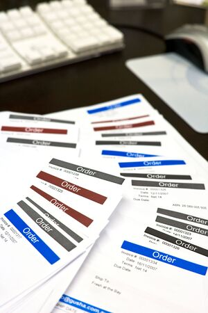 A pile of order forms on a desk Stock Photo
