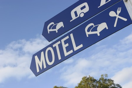 A blue street sign shows the way to accommodation Stock Photo