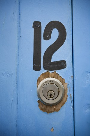 The number twelve panited on a boat shed door
