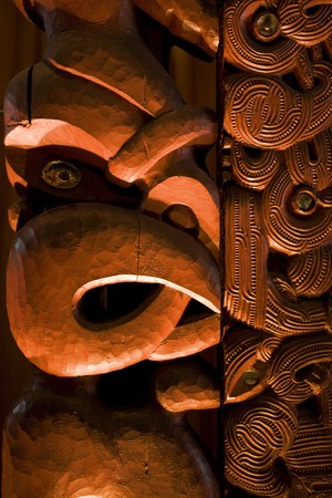 A dramatically lit Maori carving photo