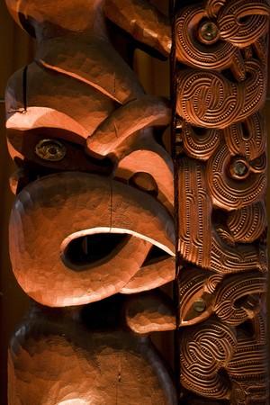 A dramatically lit Maori carving Stock Photo