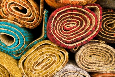 carpet and flooring: Section detail of a pile of colorful rugs Stock Photo