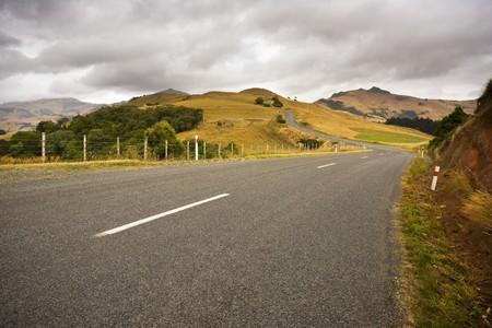 A country road twists through farmland