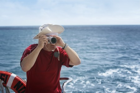 A man takes photos from a boat Stock Photo