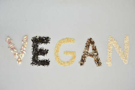 The letters of the word vegan written with vegan ingredients photo