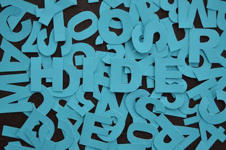 비밀 메시지 HIDE 파란색 글씨로 작성 스톡 콘텐츠