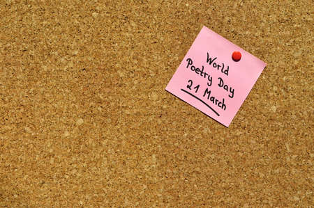 pin board: Reminder for the World Poetry Day on 21 March on a pin board Stock Photo