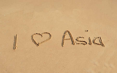 wanderlust: The text I love Asia written in the sand at a tropical beach Stock Photo