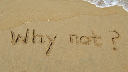 why not: The question Why not? Written in the sand at the beach Stock Photo