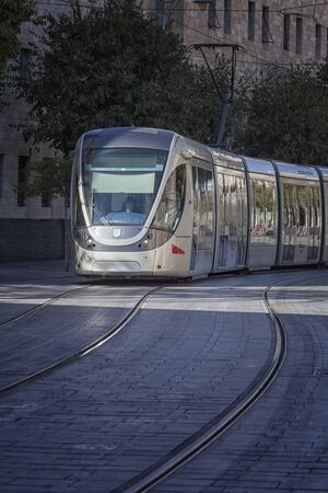 City tram in movement to a stop for disembarkation and boarding of passengers