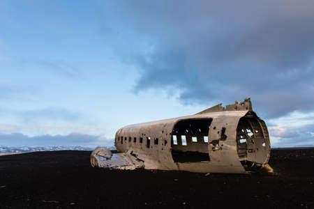 Plane crash wreckage on black sand in Iceland