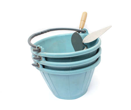 bucket and a trowel on  white  background photo