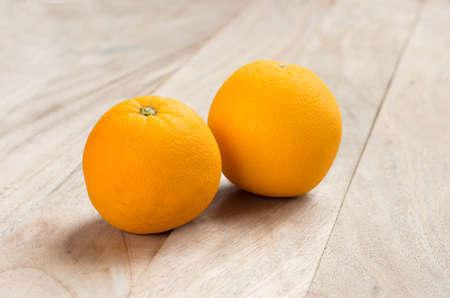 acidic: Orange fruits on the wooden floor.