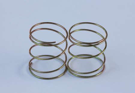 single coil: render metal  on the  floor. Stock Photo