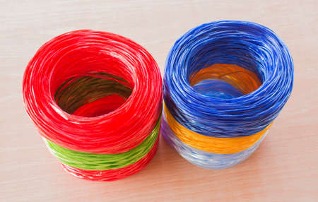 cable tangle: coil of plastic rope on the wooden floor.