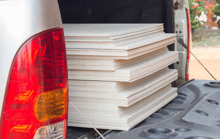 sheetrock: The stack of gypsum board for construction on the truck.