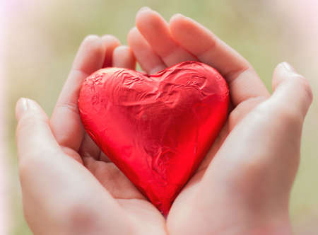 giving red heart. Stock Photo
