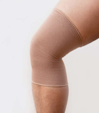 Knee injury or muscle strain or twisted  knee. Stock Photo