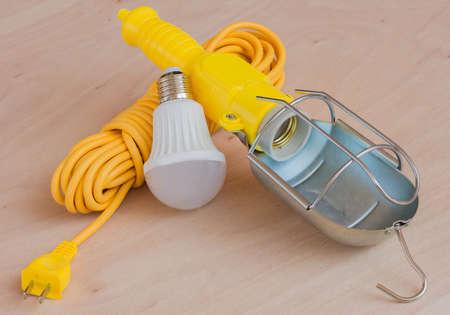 luminaire: Portable hand lamp yellow. Stock Photo