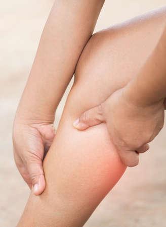 calf pain: Woman leg calf massage for pain relief. Stock Photo